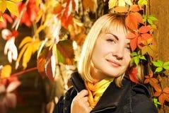 Girl on autumn background. Sexy blond girl on autumn background Royalty Free Stock Photo
