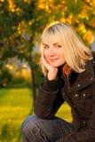 Girl on autumn background. Smiling girl on autumn background Stock Photos