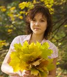 Of girl with autumn bouquet Royalty Free Stock Photography