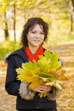 Girl with autumn bouquet in park Royalty Free Stock Image