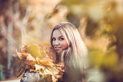Girl with autumn bouquet. Romantic girl with autumn bouquet in the park Royalty Free Stock Photography