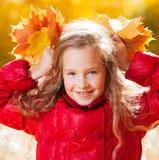 Little girl at autumn royalty free stock photo