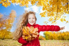 Little girl at autumn stock images