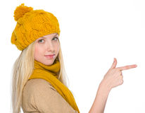 Girl in autumn clothes pointing on copy space Stock Images