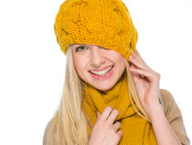 Girl in autumn clothes pulling hat over head Stock Photo