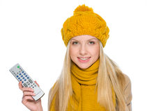 Girl in autumn clothes with tv remote control Stock Images