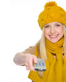 Girl in autumn clothes using tv remote control Stock Photography