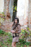 The girl in the autumn at the destroyed old building Stock Photos