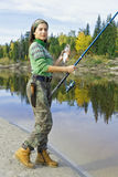 Girl on autumn fishing Stock Images