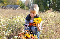 Girl with autumn flowers Stock Image