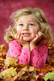 Girl in autumn foliage Stock Image