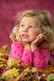Girl with autumn foliage Royalty Free Stock Images