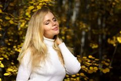 Girl in the autumn forest Royalty Free Stock Photography