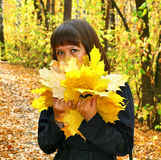 Girl in an autumn forest stock photos