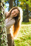 Girl in Autumn Forest Royalty Free Stock Images