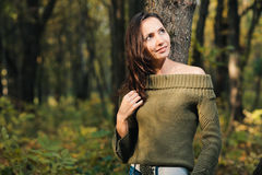 Girl in autumn forest Stock Photos