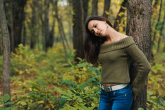 Girl in autumn forest Royalty Free Stock Photo