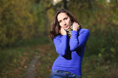 Girl in autumn forest Royalty Free Stock Photos