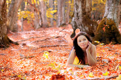 Girl in the autumn forest Royalty Free Stock Photos