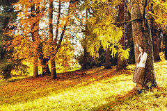 Girl in Autumn Forest Stock Photography