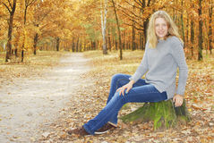 Girl in the autumn forest. Stock Photos