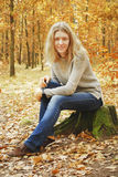 Girl in the autumn forest. Royalty Free Stock Image
