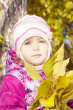 Girl in the autumn forest Stock Photography