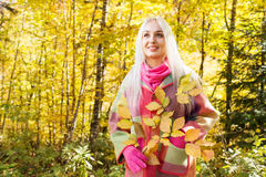 Girl in the autumn forest Royalty Free Stock Images