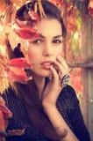Girl in autumn garden Royalty Free Stock Photo