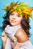 Girl in autumn garland Stock Images