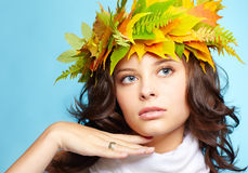 Girl in autumn garland Royalty Free Stock Photography