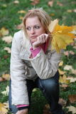 The girl in autumn on green. The beaty girl in autumn Royalty Free Stock Photography