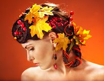 Girl with  autumn hairstyle and make up. Stock Photos