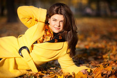 Girl in autumn. Happy beautiful girl in autumn with yellow leaves Stock Images
