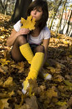 Girl in autumn with leaf. Photo of girl in autumn forest Stock Photos
