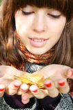 The girl with an autumn leaf. Royalty Free Stock Photography