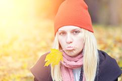 Girl with autumn leaf Royalty Free Stock Image