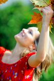Girl with autumn leaf outdoor Stock Images