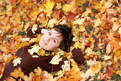 Girl in autumn leafs Stock Photography