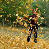 Girl in autumn leafs Royalty Free Stock Images
