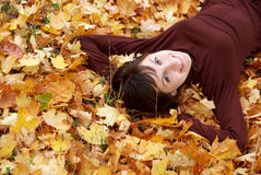Girl in the autumn leafs Royalty Free Stock Image