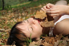 Girl with autumn leaves. 