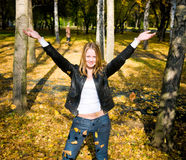 Girl and autumn leaves. Happy girl and autumn leaves Stock Photography