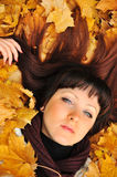 The girl in autumn leaves Stock Photo