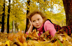 Girl in autumn leaves Royalty Free Stock Photo