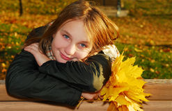 Girl with autumn leaves Royalty Free Stock Photo