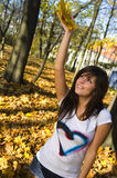 Girl with autumn leaves. Photo of girl in autumn forest Royalty Free Stock Images