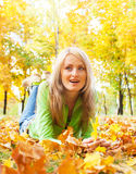 Girl on autumn leaves Stock Photo