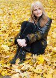 Girl in autumn leaves Royalty Free Stock Photography