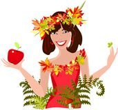 Girl with autumn leaves and apple Royalty Free Stock Image